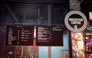 HUCKSTER Interior Experiential Neon Sign Designer